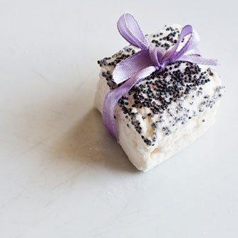 gourmet marshmallow topped with poppy seeds and topped with a lavender bow